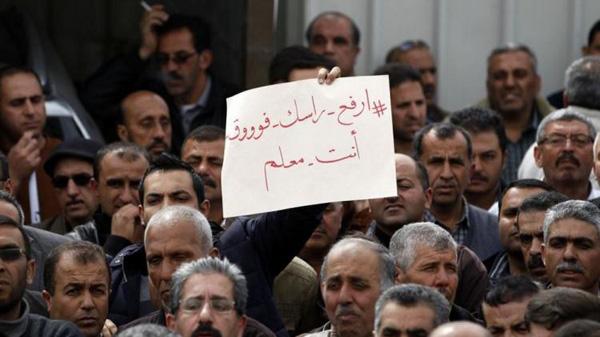 Les enseignants palestiniens en grève manifestent à travers la Cisjordanie